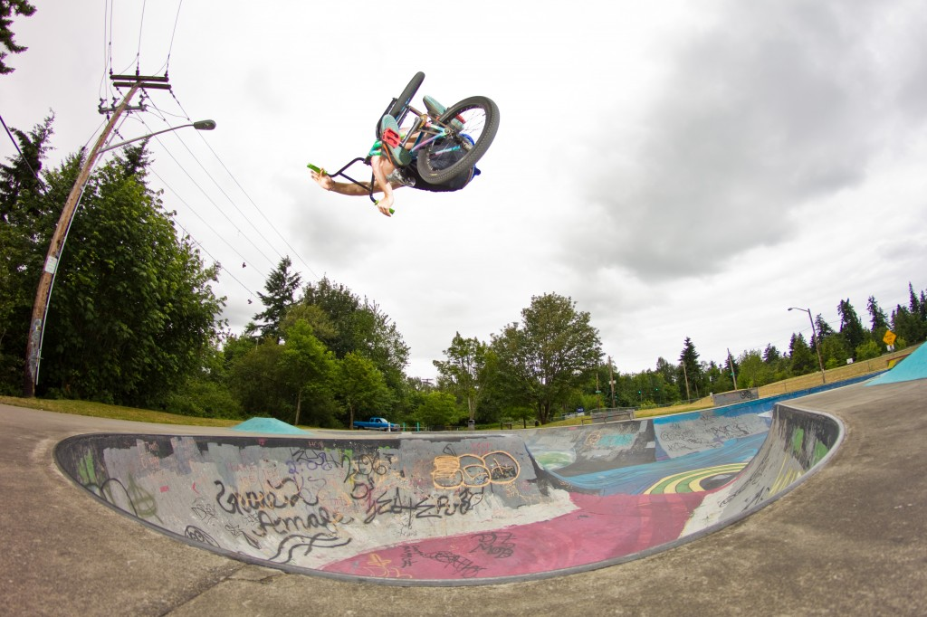 Jake Ortiz flipping the table on his back with a massive invert