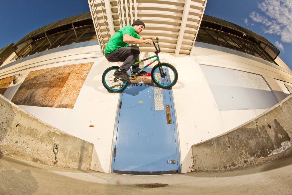 Jake Ortiz Wall ride on a door over a gap with a very low roof.